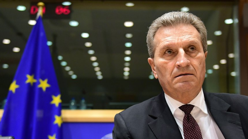 Germany's European Commissioner for the digital economy and society Guenther Oettinger attends a hearing in front of an European Parliament committee on the transfer of his portfolio to the budget and human resources commission, at the European Parliament in Brussels, January 9, 2017. / AFP PHOTO / EMMANUEL DUNAND